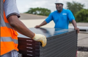The installation of the state-of-the-art solar photovoltaic (PV) array at Jamaica House—the Office of the Prime Minister. (Courtesy: Solar Head of State)