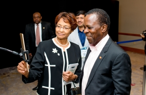 Secretary General Bernadette Lewis demonstrates the use of facial recognition to Prime Minister Dr. the Right Honourable Keith Mitchell during a tour of Caribbean FutureScape