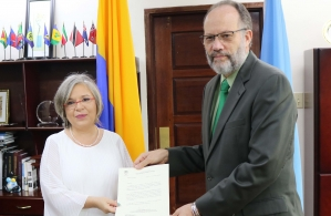 Her Excellency Martha Pinilla, Colombia's Ambassador to the CARICOM presenting her Letters of Accreditation to Ambassador LaRocque, CARICOM Secretary-General