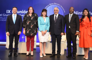 Hon. Miguel Vargas,  Foreign Minister of the Dominican Republic (3rd from right),  H.E. Robin Bernstein,  US Ambassador to the Dominican Republic (3rd from left) and Sherwin Toyne Stephenson, Programme Manager, Crime and Security, CARICOM Secretariat