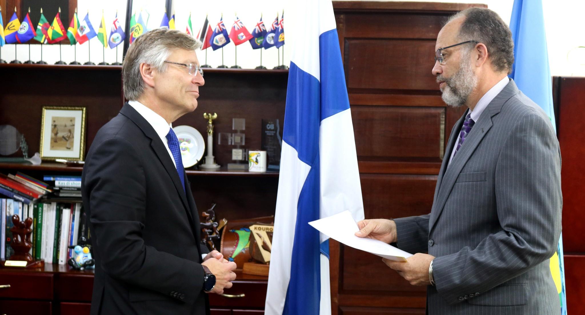 Amb. Irwin La Rocque receives the credentials of His Excellency Pertti Ikonen
